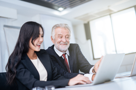 Businessman and businesswoman working in office Imagens