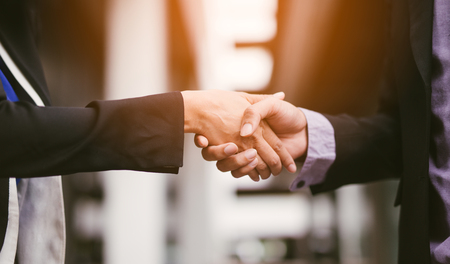 Business people partnership handshake concept.Photo two businessman handshaking process. Imagens