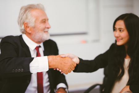 Business people partnership handshake concept.Photo two businessman handshaking process.Successful deal after great meeting. blurred background