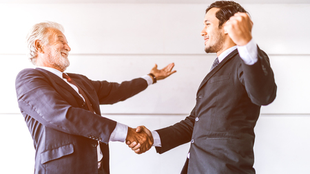 Success businessman shaking hands for successful .handshake of business