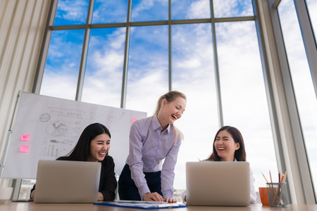 Young women working together, office interior Imagens