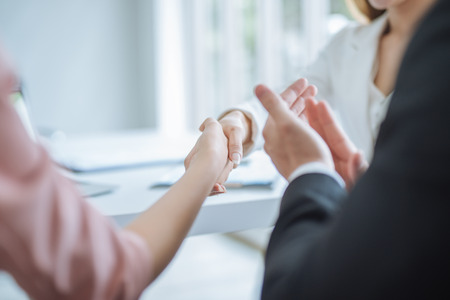handshake of business. business woman shaking hands in office. Business people clapping their hands, congratulation and appreciation for successful dealing and agreement