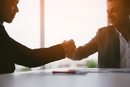handshake business concept. business people shaking hands in office. Imagens