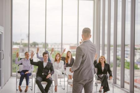 Businessman speaker giving a talk at business meeting. Audience in conference room. Reklamní fotografie