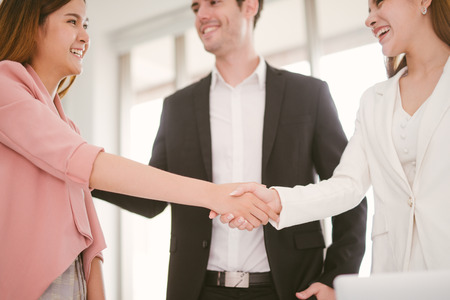 handshake business concept. business woman shaking hands in office. Imagens - 119505591