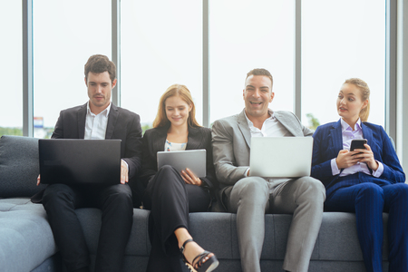 happy creative business people with laptop and digital tablet in the office Imagens