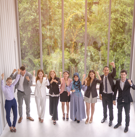 Group of successful business people happy in modern nature office