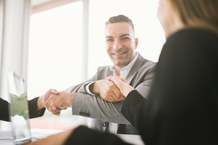 handshake of business. businessman shaking hands in office. Business people shaking hands for successful dealing and agreement 版權商用圖片
