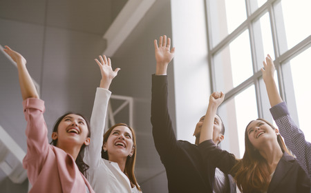 Successful of Business People Celebrating In office. Group of Happy business team hands raised for success and winning. Startup of young Asian businessman and businesswoman happy and smiling. Imagens
