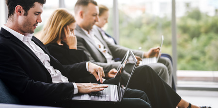 Group of Business people sitting on sofa using laptop Imagens