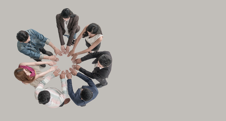 Top view of people in team hands at the circle together as unity and teamwork in office. young Asian team and group togetherness collaboration