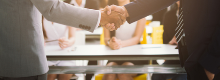 handshake business concept. businessman shaking hands in office.
