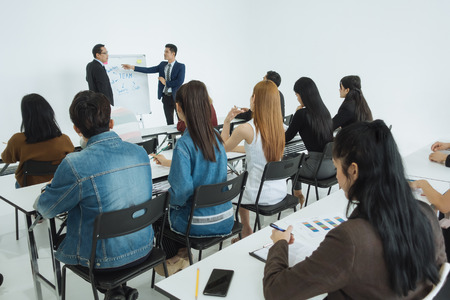 Two businessman presentation in a conference meeting room and Audience of the lecturer Imagens - 119501634