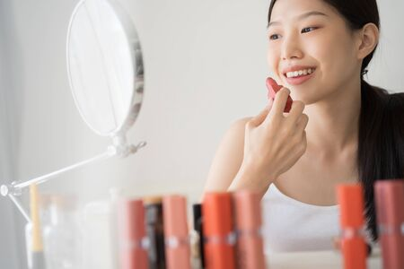 Young Asian female makeup beauty by lipstick