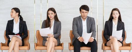 Asian business people are stressed about waiting for a job interview.