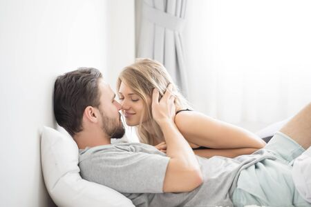 Young couple kissing in the bed .loving couple in bedroom