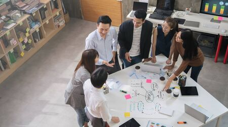 Group of Asian business people team meeting in modern office working design planning and ideas concept