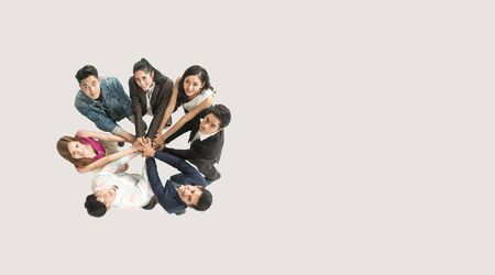 Top view of business people standing with their hands together in a huddle stack hand teamwork assemble together. Zdjęcie Seryjne