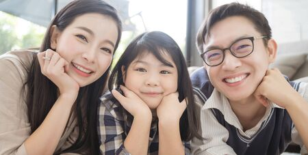 Portrait of happy asian family spending time together in living room. family and home concept Stock Photo - 137220092