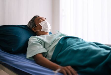 old mature patient  in hospital ward on hospital bed wear protection mask for prevent the spread of the virus Reklamní fotografie
