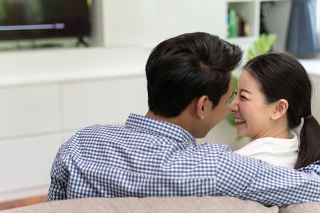 Romance Asian couple watching television at home