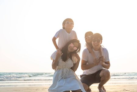Portrait Asian Family in the beach with kids happy vacation concept.