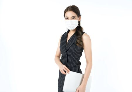 Young happy Asian woman wearing hygienic mask to prevent infection corona virus Air pollution pm2.5 she wearing business casual shirt shoot in shot isolated on white background