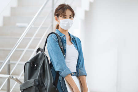 Young student woman wearing face mask