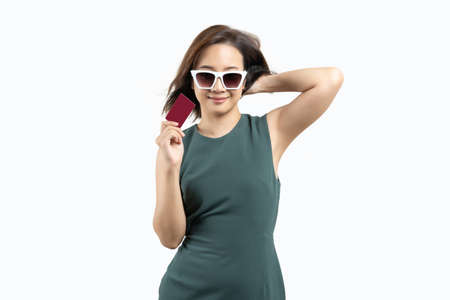 Young beauty Asian woman wearing sunglasses and showing credit card blank card on white isolate background. fashion shopping concept