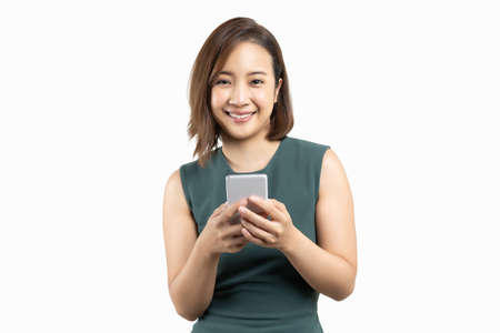 Young beauty Asian woman using smart phone on white isolate background Reklamní fotografie