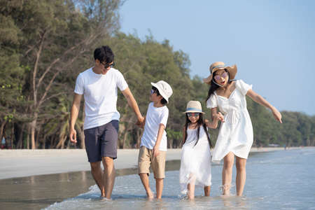 Asian Family walking at beach with kids happy vacation concept Reklamní fotografie