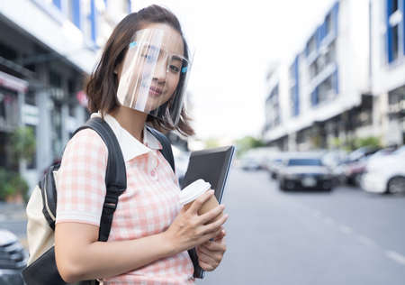 Young student Asian woman wearing mask face shield Reklamní fotografie
