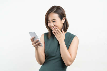 Young beauty Asian woman using smart phone on white isolate background Stock fotó