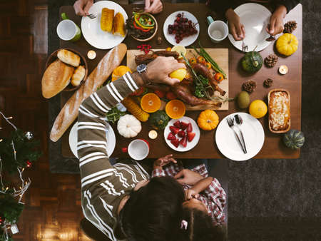 Group of people enjoying dinner with turkey together. Dining Wine Cheers Party thanksgiving Concept