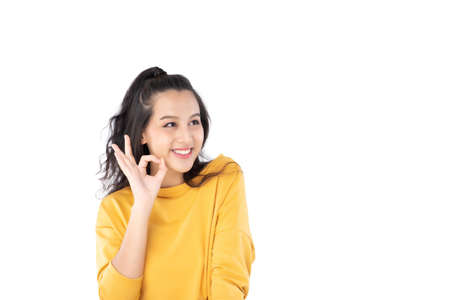 Asian young woman showing okay gesture on isolate white background