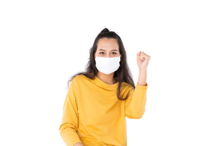 Young happy Asian woman wearing hygienic mask