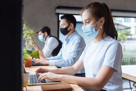 Asian people wearing mask working at coffee shop