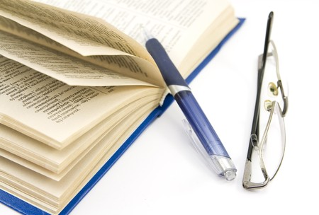 book, pen and glasses isolated photo