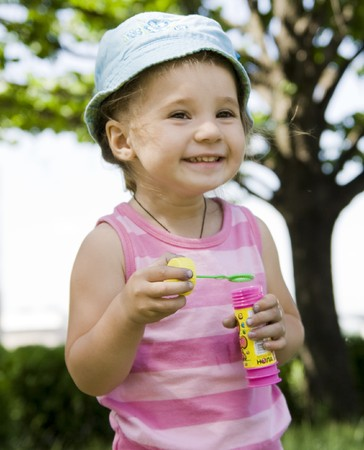 girl with soap bubbles smiling Stock Photo - 4479571