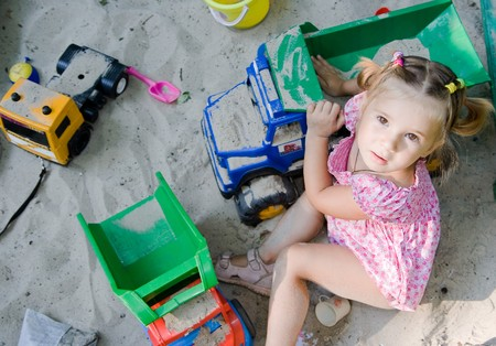 little girl in sandbox photo