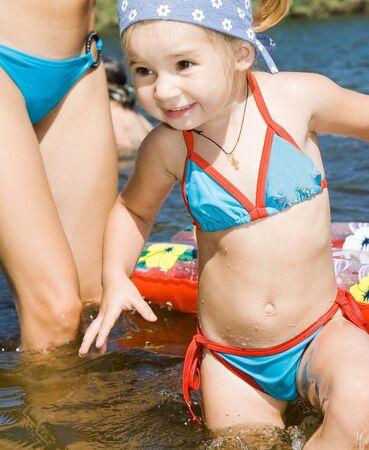 little girl bathing in river Stock Photo