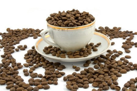 coffeecup: coffee beans and coffeecup isolated on white