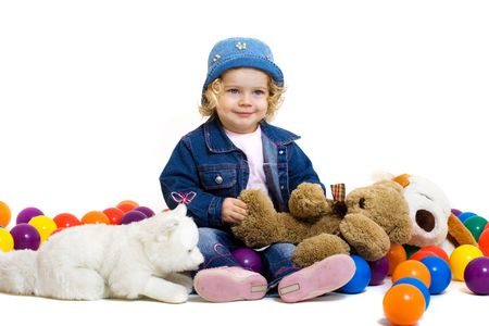 portrait of cute little girl with toys photo