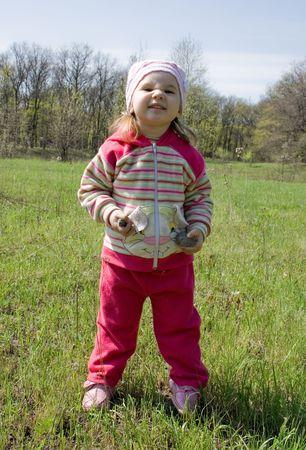 grimacing: little girl grimacing on the meadow