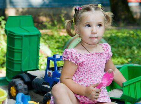 the sandbox: playing little girl