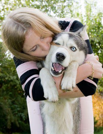 girl kissing her dog photo