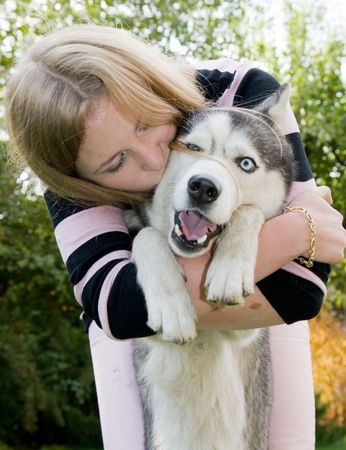 blue eye husky: girl kissing her dog