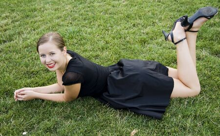 young girl lying on green grass Stock Photo - 6299248