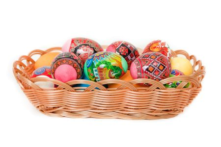 easter eggs in basket isolated on white photo