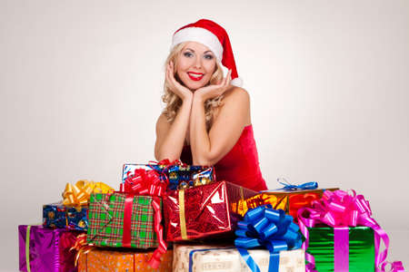 beautiful blond girl in christmas costume with gifts Stock Photo